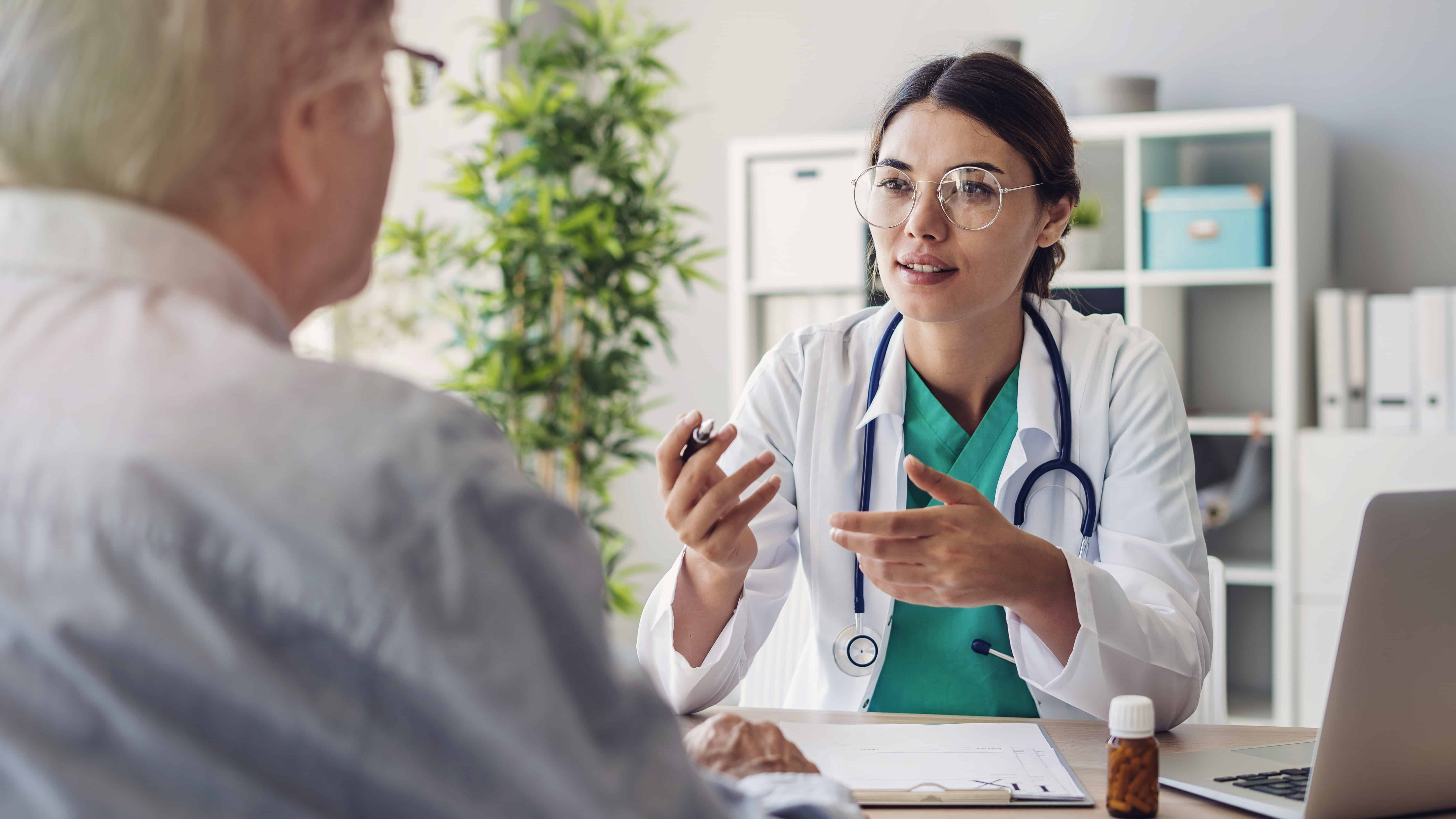 Female doctor speaking to patient in office setting
